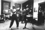 Former USA Olympian Antonio Tarver hits boxing mitts in his dressing room prior to a bout during Fight Night at the Blue Horizon on April 29, 1997 in Philadelphia, Pennsylvania