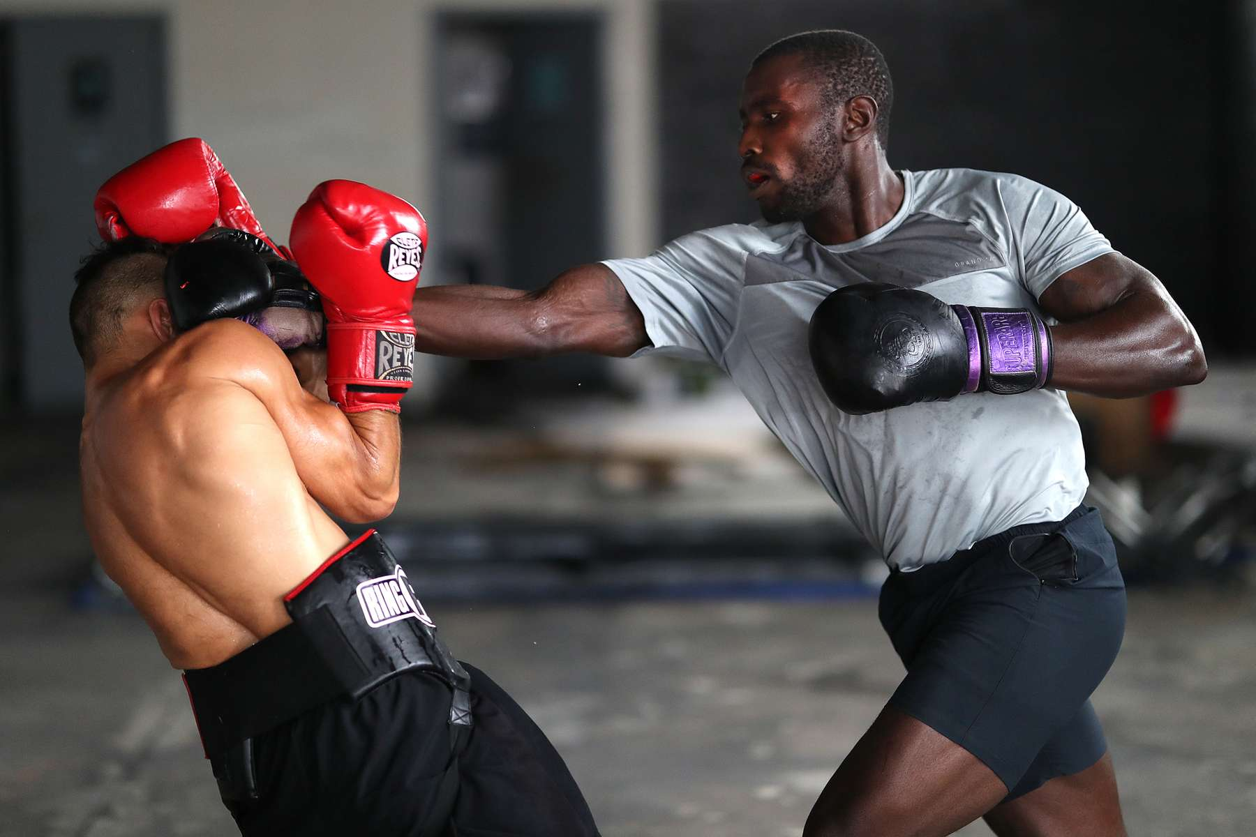 New York Golden Gloves boxer Dennis Guerrero (left) spars with recreational boxer Raheem Yusuff during training session in a warehouse that was once Jetty gym on July 30, 2020 in Oceanside, New York.  Guerrero, who is a co owner of Jetty has tried to hold many types of outdoor and open air workouts while the gym remains closed due to the coronavirus pandemic.  Since all gyms in New York had been closed since March 13, they have been trying to keep up financially to sustain the gym. Guerrero and his partner Michael Levitz have decided to closed their doors for good next week.  They will be moving their workouts online and at select locations.  Governor Andrew Cuomo announced that gyms will not be permitted to reopen during phase 4 until New York's Health Department determines if air filtering systems are circulating the coronavirus. More than 4,540,000 people in the United States alone have been infected with the coronavirus and at least 154,000 have died.