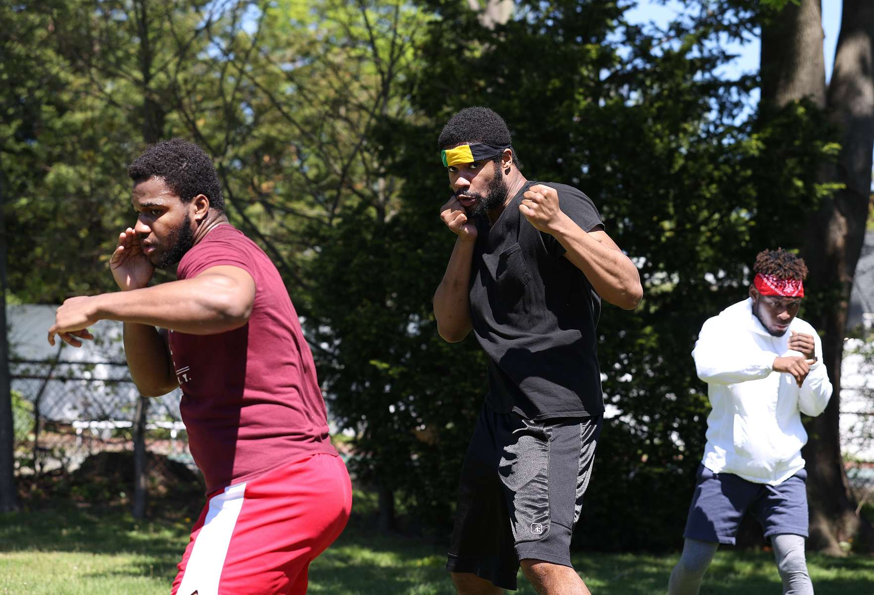 Amateur Boxers Kevens Desroches, Raymond Young, and Kerry Duperval train in the backyard of Westbury Boxing Club Trainer Matt Happaney on May 02, 2020 in Mineola, New York.  Local Amateur Boxers have continued To train as best they can during coronavirus COVID-19 Pandemic.  The World Health Organization declared coronavirus (COVID-19) a global pandemic on March 11th.