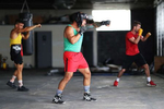 Amateur Kickboxer Sal Carillo (Front), New York Golden Gloves boxer Dennis Guerrero (right), and three time New York Golden Glove boxer Anthony Lopez, shadowbox during training session in a warehouse that was once Jetty gym on July 30, 2020 in Oceanside, New York. Guerrero, who is a co owner of Jetty has tried to hold many types of outdoor and open air workouts while the gym remains closed due to the coronavirus pandemic.  Since all gyms in New York had been closed since March 13, they have been trying to keep up financially to sustain the gym. Guerrero and his partner Michael Levitz have decided to closed their doors for good next week.  They will be moving their workouts online and at select locations.  Governor Andrew Cuomo announced that gyms will not be permitted to reopen during phase 4 until New York's Health Department determines if air filtering systems are circulating the coronavirus. More than 4,540,000 people in the United States alone have been infected with the coronavirus and at least 154,000 have died.