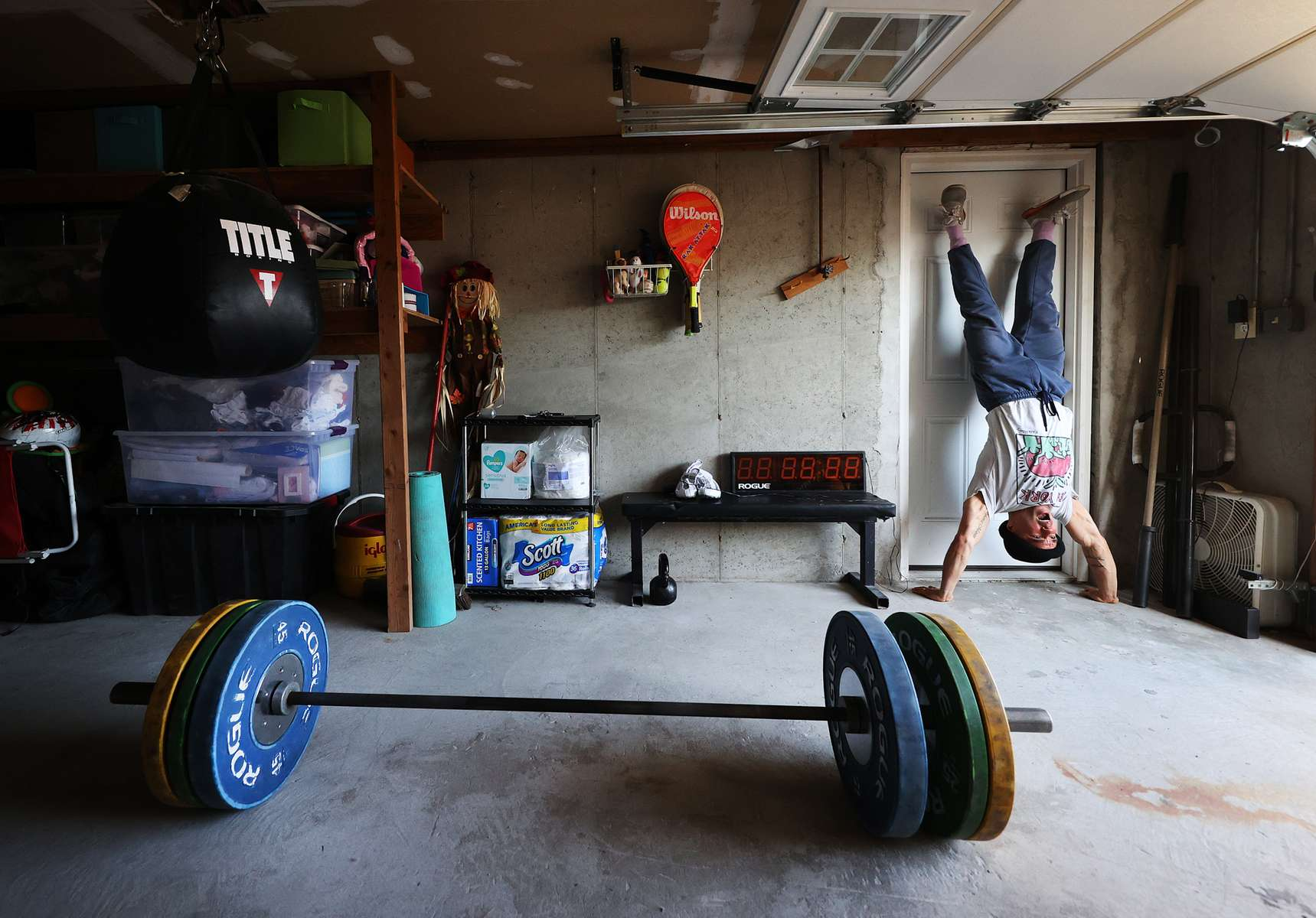 Dennis Guerrero trains in his garage at his home on May 13, 2020 in Long Beach, New York.  Dennis is an Amateur boxer and has competed in the New York City Golden Gloves.  He also owns a CrossFit Gym called CrossFit Jetty in Oceanside, New York. He was training to compete in this year's Golden Gloves tournament but it has been cancelled due to the coronavirus pandemic.  He also co owns a CrossFit Gym called CrossFit Jetty.  His gym has been closed by New York Governor Andrew Cuomo since March 16th due to the coronavirus COVID-19 pandemic.  Until the gyms are deemed safe to open he will continue to stay fit by training at home with the hope that he can box again later this year.