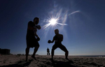 LONG BEACH, NEW YORK - AUGUST 18:  Members of the {quote}Life Outside the Box{quote} fitness club participate in a boxing sparring session at the beach on August 18, 2020 in Long Beach, New York.  Gyms, which have been closed in New York since mid-March to help prevent the spread of the coronavirus, will be allowed to open again as soon as August 24th Governor Andrew Cuomo has announced.  Gyms will be limited to a third of their capacity, and they need to maintain a sign-in sheet to help contact tracers in case of a virus outbreak. Air filters must be able to help prevent the transmission of viral particles. People must wear masks at all times (Photo by Al Bello/Getty Images)