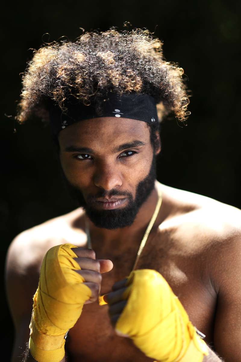 Khamall Dunkley poses for a portrait on May 20, 2020 in Freeport New York.  Khamall is an Amateur boxer who fought in the New York City Golden Gloves and made the Quarter Finals in the Novice 141lb class. He was training to compete in this year's Golden Gloves tournament in the Open Class but it has been cancelled due to the coronavirus pandemic. The Gym he fights for, the Freeport Boxing Club, has been closed since March 16th. Until gyms are deemed safe to open he will continue to stay fit by training at home with the hope that he can box again later this year.