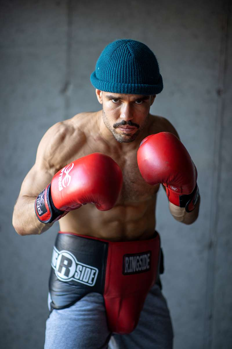 Amateur Boxer, and Head Trainer of Life Outside the Box fitness Dennis Guerrero, poses for a portrait in his garage on November 8th, 2020 in Long Beach, New York.  Due to the Coronavirus pandemic, many gyms across the country have been unable to sustain their business and had to close.  Jetty gym was one of the fitness clubs who had to shut their doors. They have since reinvented themselves and are now called Life Outside the Box.  Their business model has changed drastically, and all their workouts have gone virtual.  The workouts are conducted by a small group of fitness trainers led by Dennis Guerrero.  The members pay a monthly fee and can take as many live fitness classes as they want.  They are coached by the virtual trainers in real time.  More and more people have reconstructed their garages, spare rooms, backyards, and basements into home gyms since the COVID-19 pandemic hit the United States this past March.
