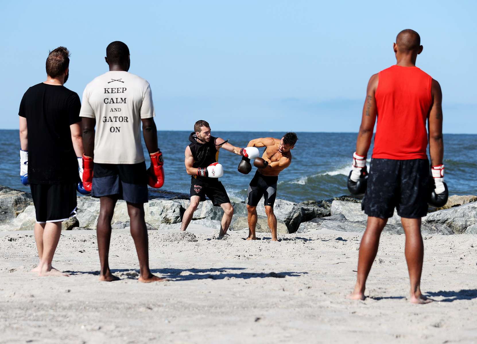 Amateur Boxers Dennis Guerrero and Anthony Lopez who are members of the {quote}Life Outside the Box{quote} Fitness Club, participate in a sparring session at the beach on August 18, 2020 in Long Beach, New York. Gyms, which have been closed in New York since mid-March to help prevent the spread of the coronavirus, will be allowed to open again as soon as August 24th Governor Andrew Cuomo has announced.  Gyms will be limited to a third of their capacity, and they need to maintain a sign-in sheet to help contact tracers in case of a virus outbreak. Air filters must be able to help prevent the transmission of viral particles. People must wear masks at all times