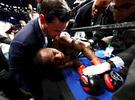 Charles Hatley is knocked out in the sixth round by Jermell Charlo during their WBC junior middleweight title bout at the Barclays Center on April 22, 2017 in New York City.
