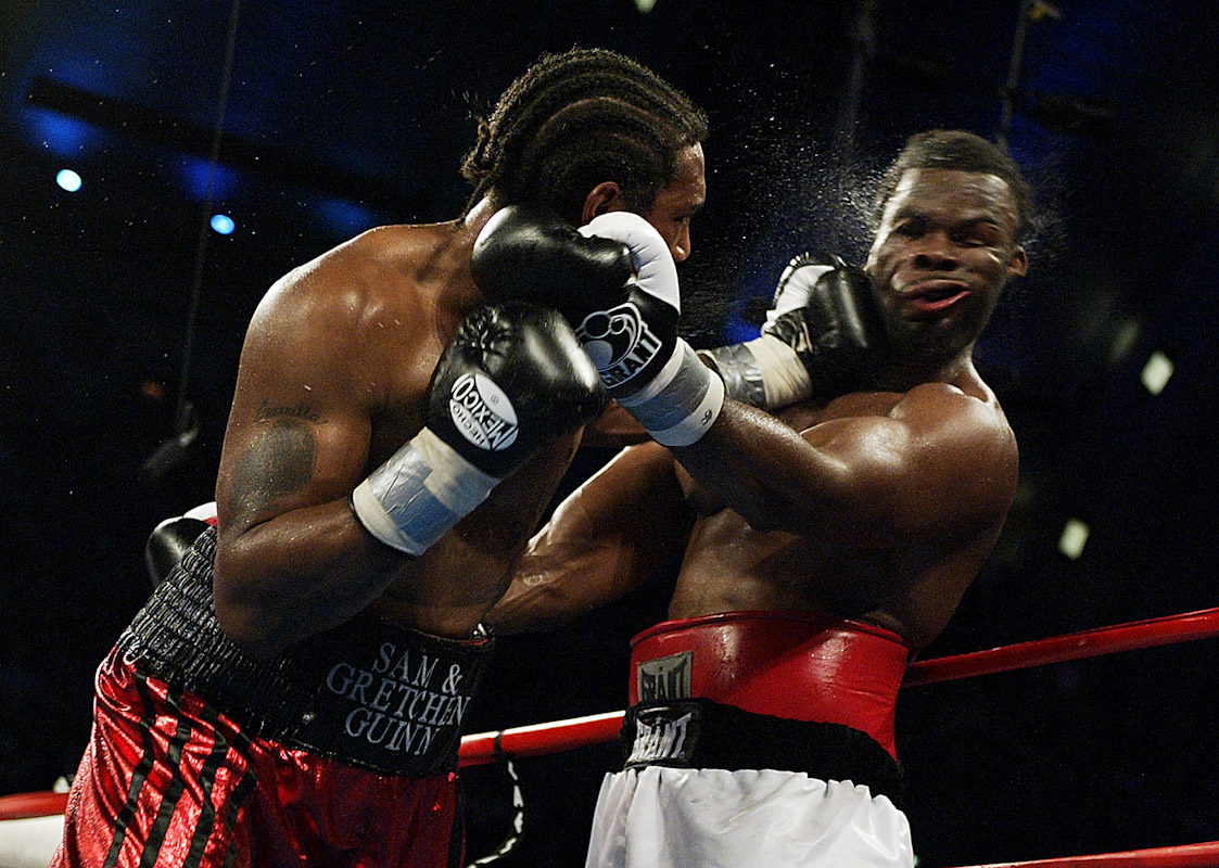 Dominick Guinn knocks out Michael Grant with a left hook in the seventh round of their Heavyweight bout at Boardwalk Hall on June 7 in Atlantic City, New Jersey.