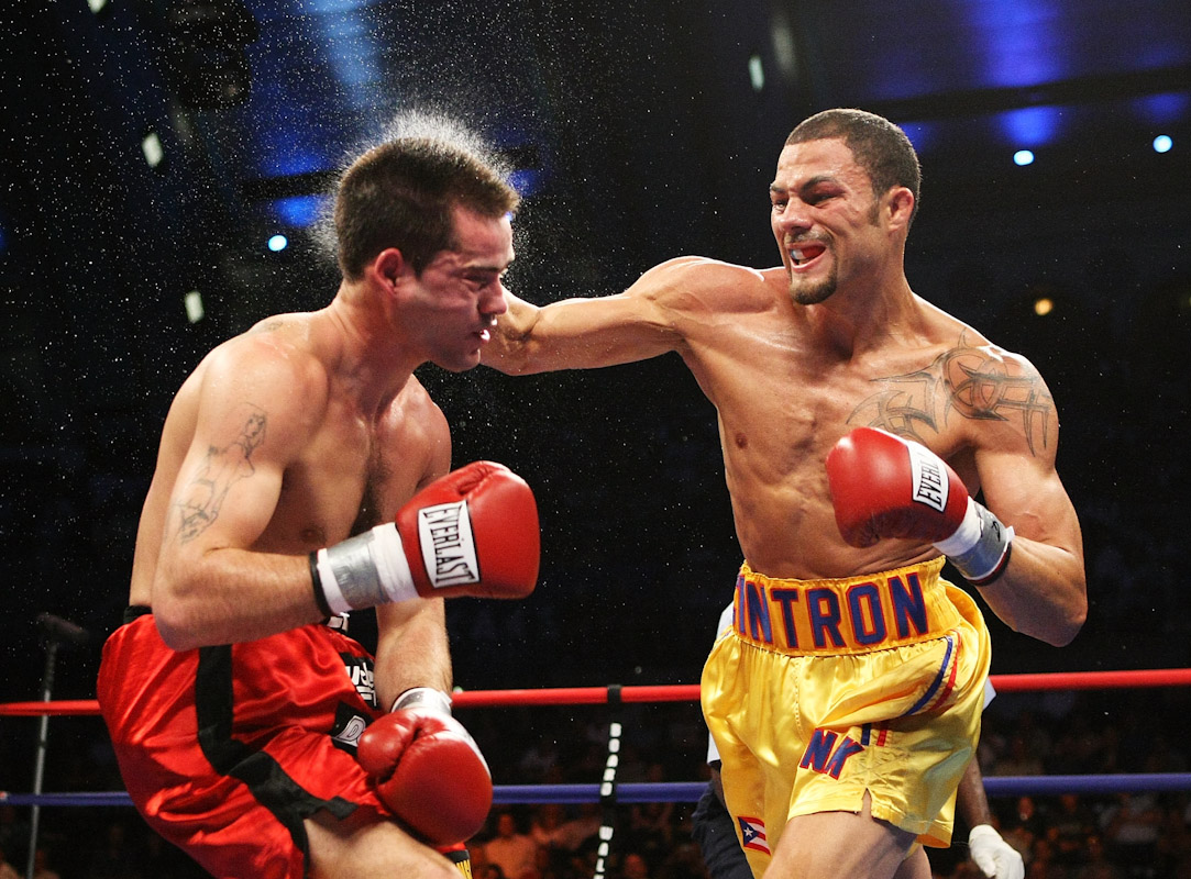 Kermit Cintron knocks out Walter Mathysse in the second round during their IBF Welterweight Championship fight on July 14, 2007 at Boardwalk Hall in Atlantic City, New Jersey.