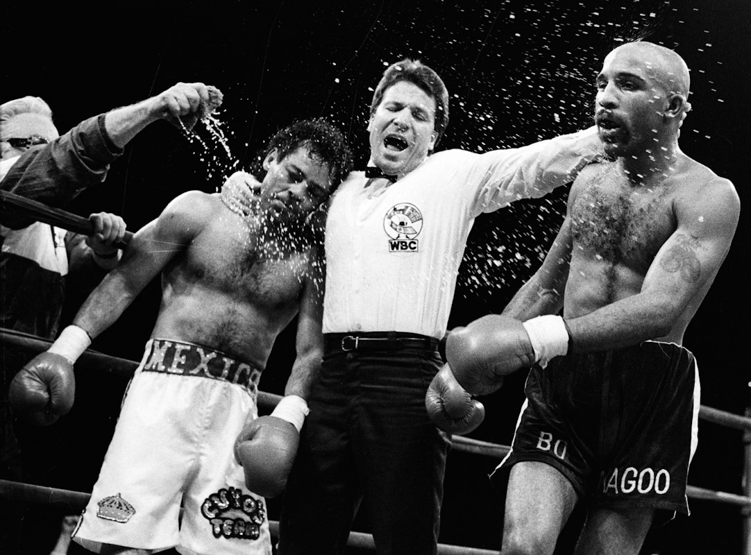 Referee Arthur Mercante Jr. separates Genaro Leon and James Buddy McGirt after their fight at The Paramount Theatre on January 12, 1991 in New York City.
