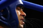 Marian Simion of Romania gets a water break in his corner between rounds in his bout against Ramadan Yasser of Egypt during the men's boxing 51 kg preliminary bout on August 21, 2004 during the Athens 2004 Summer Olympic Games at Peristeri Olympic Boxing Hall in Athens, Greece.