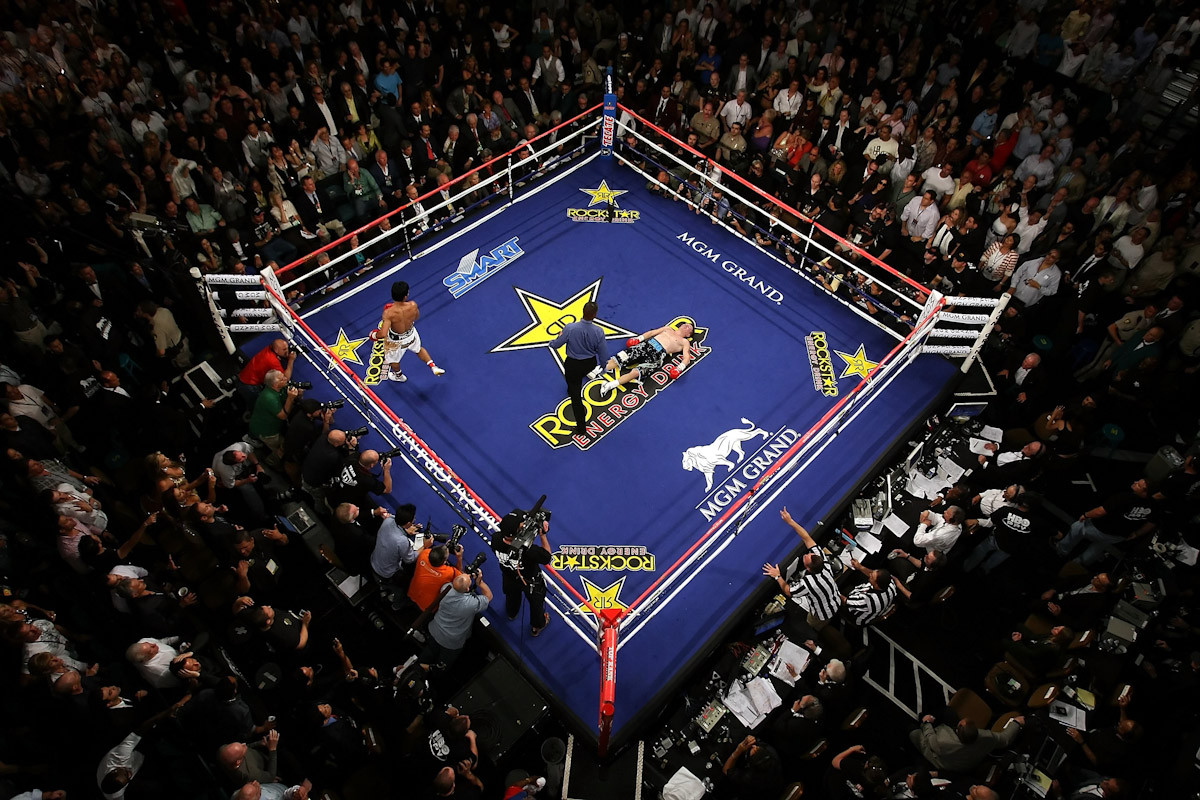 Manny Pacquiao of the Philippines walks to his corner after knocking out Ricky Hatton of England in the second round during their junior welterweight title fight at the MGM Grand Garden Arena May 2, 2009 in Las Vegas, Nevada.