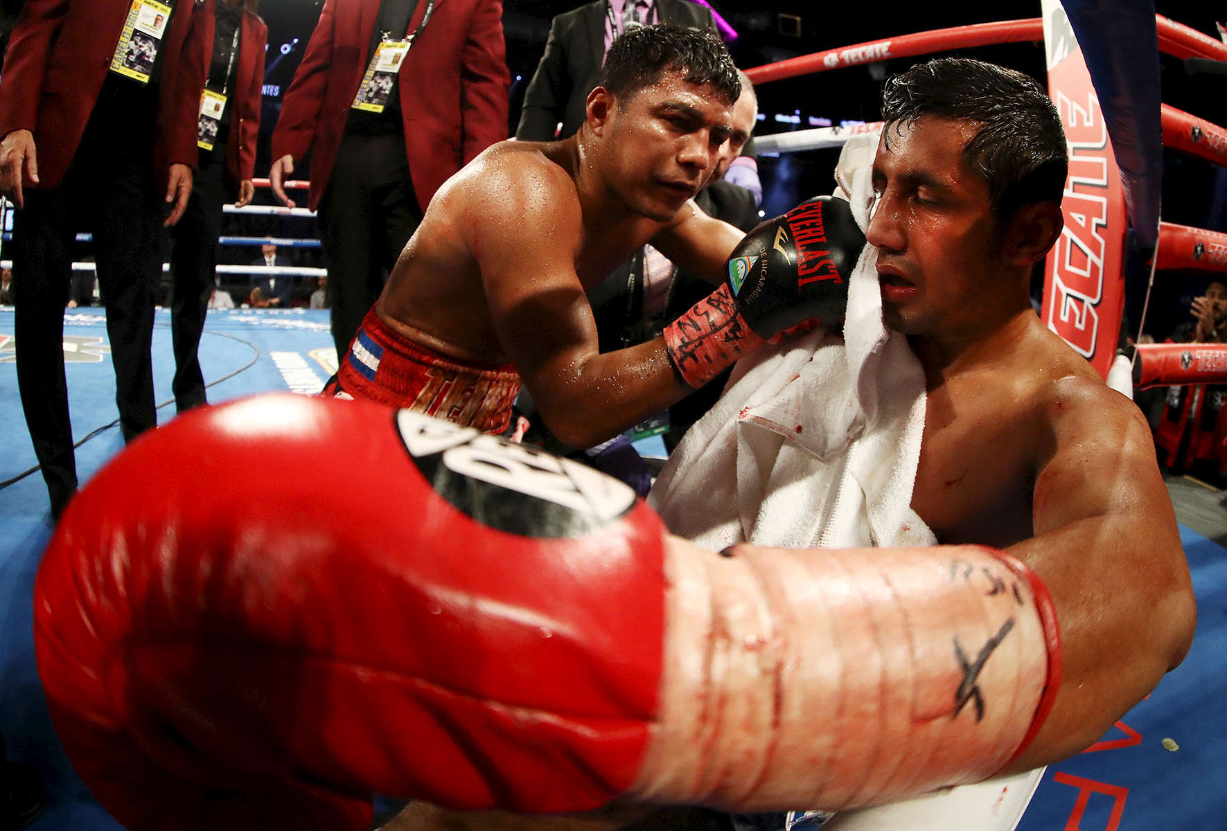 Roman Gonzalez consoles Moises Fuentes after knocking him out in the first round during their super flyweight bout at T-Mobile Arena on September 15, 2018 in Las Vegas, Nevada.