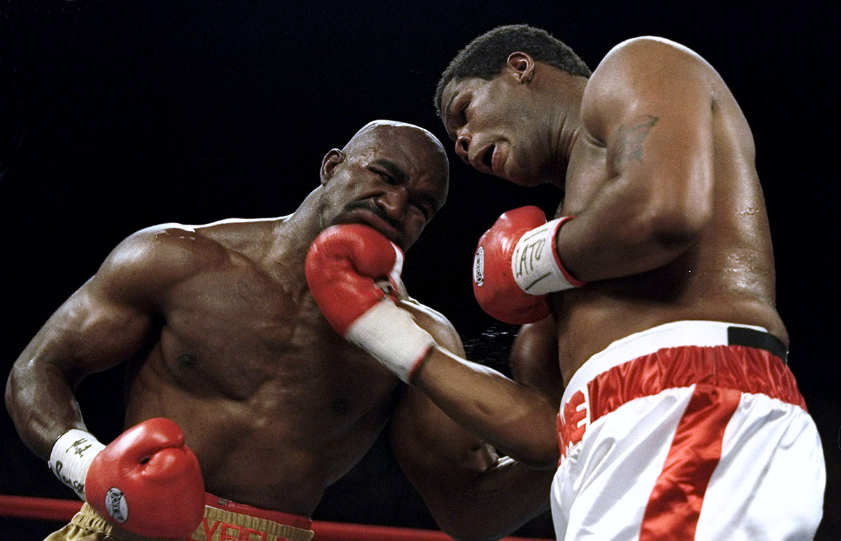 4 Nov 1995:  Evander Holyfield takes a uppercut to the jaw by Riddick Bowe during the fight at Caesars Palace in Las Vegas, Navada.Mandatory Credit: Al Bello  /Allsport