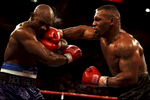 9 Nov 1996:  Mike Tyson hits Evander Holyfield before losing by TKO in the 11th round during their bout at the MGM Grand Garden in Las Vegas, Nevada.