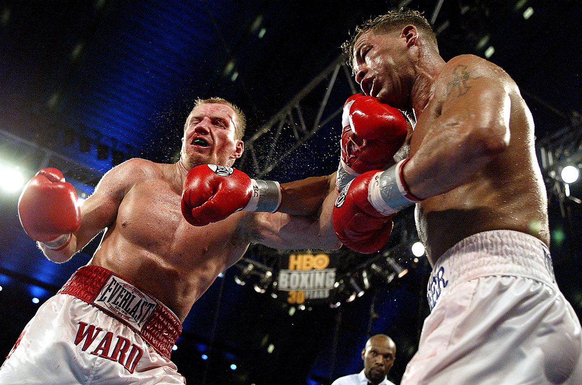 Arturo Gatti (L) and Micky Ward trade punches during their Junior Welterweight bout at Boardwalk Hall on June 7, 2003 in Atlantic City, New Jersey. Gatti won a unanimous decision.