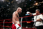 Bebis Mendoza (red shorts) is doused with water during a break in the fight with Rosendo Alvarez for the WBA light flyweight title at Madison Square Garden on October 2, 2004 in New York City. Rosendo Alvarez defeated Bebis Mendoza.