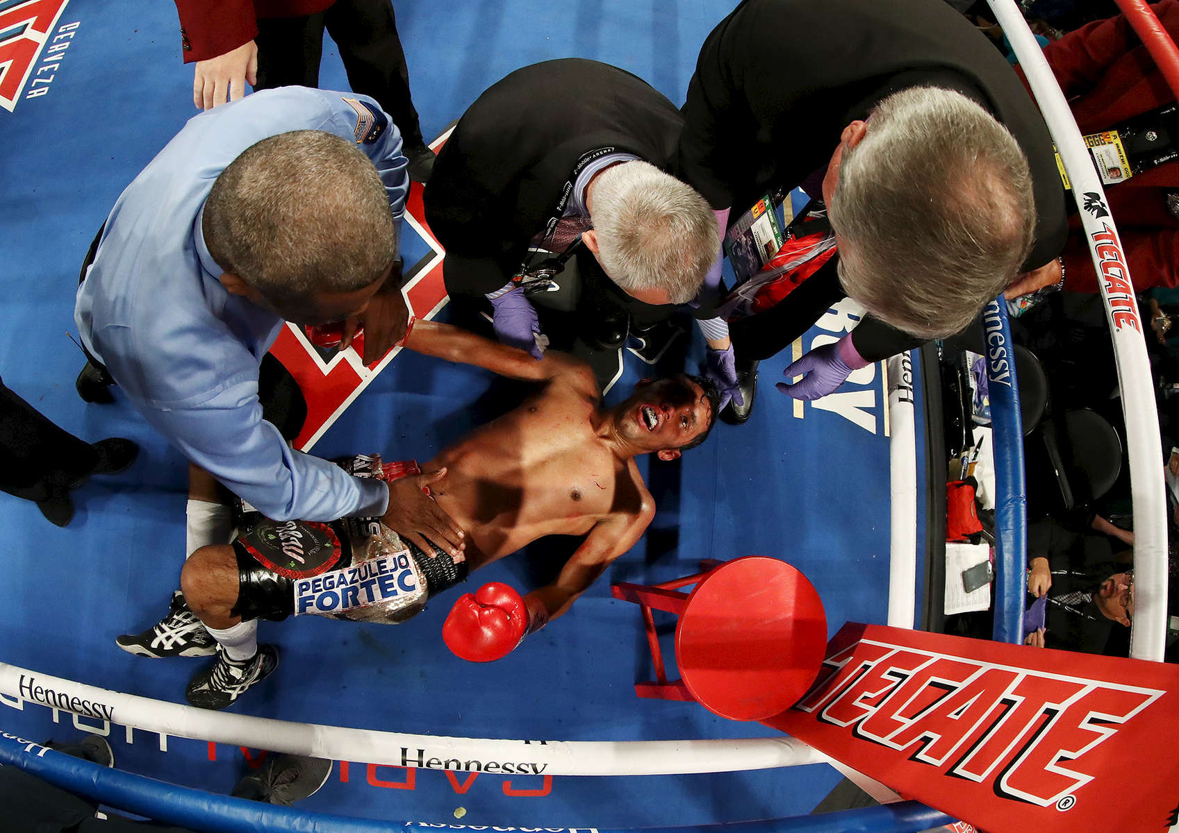 Moises Fuentes is attended to after being knocked out in the fifth round by Roman Gonzalez during their super flyweight bout at T-Mobile Arena on September 15, 2018 in Las Vegas, Nevada.