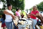 Families cook their ethnic food in the park as the Competitors participate in the Fedeiguayas Soccer League on August 26, 2007 at Flushing Meadows Park in Queens,  New York.