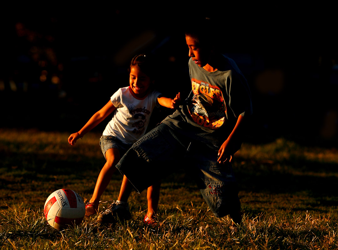 Children play a pickup game of soccer as their adult relatives participate in the Fedeiguayas Soccer League on September 2, 2007 at Flushing Meadows Park in Queens, New York.