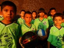 A boys soccer team poses before practice as their adult relatives participate in the Fedeiguayas Soccer League on September 5, 2007 at Flushing Meadows Park in Queens, New York.