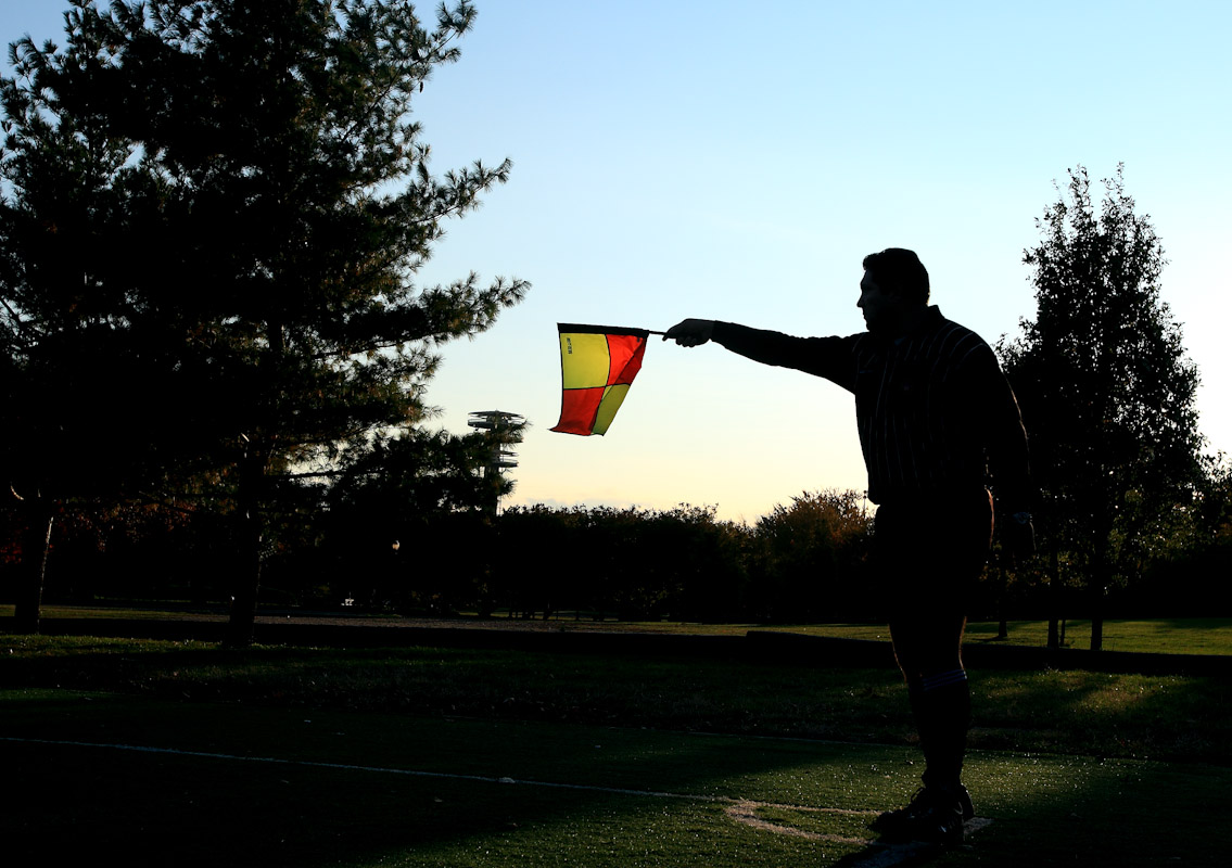 A referee signals with his flag as competitors participate in the Fedeiguayas Soccer League on November 10, 2007 at Flushing Meadows Park in Queens New York