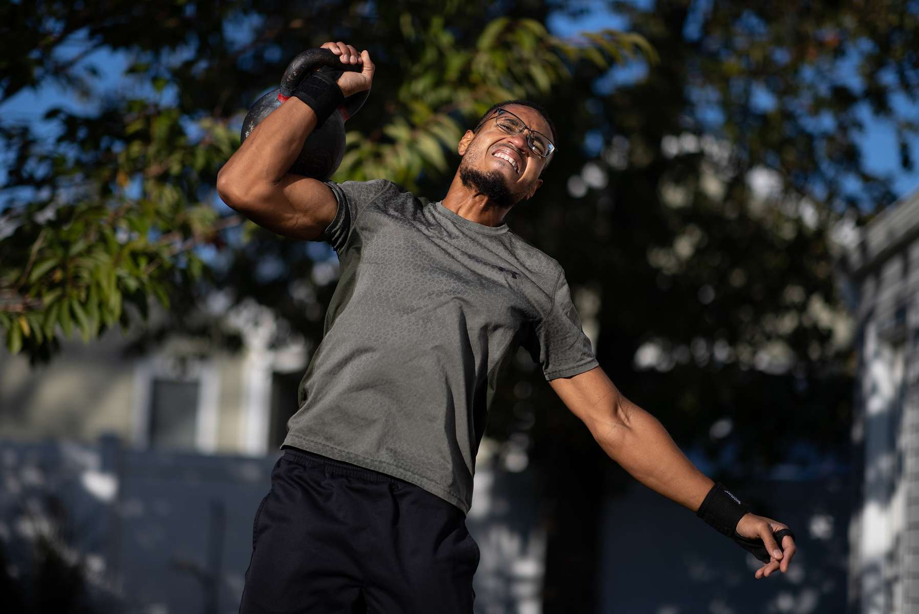 Korbin Cleveland exercises with his virtual Fitness Trainer Dennis Guerrero on October 31, 2020 in Island Park, New York. In March of 2014, Dennis Guerrero and his business partner opened a gym on Long Island. The pair shared a passion for fitness, a dream of creating a local community of like-minded people and a willingness to take a risk. Over the next six years, hundreds of members experienced and embraced a unique environment that fostered a palpable energy, helping athletes of all ages and abilities reach their potential.  The gym became a place to share achievements, work through losses and overcome illness. But like so many other businesses, it seemingly had no way of overcoming the financial impact and ongoing uncertainty of a global pandemic. With the arrival of Covid-19, the gym shut its doors back in March, with no idea when it would reopen. The owners, though, were far from done. They lent out every piece of equipment they owned to the gym's members, continued to pay their staff and worked to set up outdoor classes in hopes of keeping their membership active and healthy. As the shutdown stretched on, it became clear that the physical gym was closed for good.  They have since reinvented themselves and are now called Life Outside the Box.  Their business model has changed drastically, and all their workouts have gone virtual.  The workouts are conducted by a small group of fitness trainers led by Guerrero.  The members pay a monthly fee and can take live Zoom fitness classes.  They are coached by the virtual trainers in real time.  More and more people have reconstructed their garages, spare rooms, backyards, and basements into home gyms since the COVID-19 pandemic hit the United States.