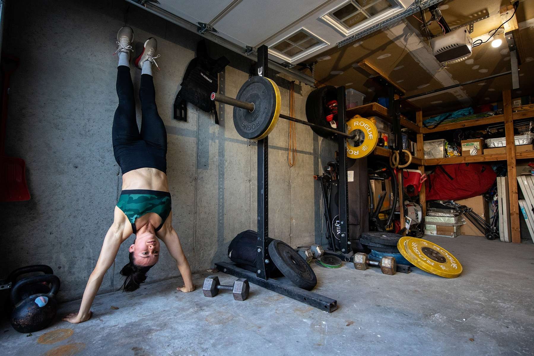 Nicole Guerrero exercises in her garage with her virtual Fitness Trainer and Husband Dennis Guerrero on November 21st, 2020 in Long Beach, New York. In March of 2014, Dennis Guerrero and his business partner opened a gym on Long Island. The pair shared a passion for fitness, a dream of creating a local community of like-minded people and a willingness to take a risk. Over the next six years, hundreds of members experienced and embraced a unique environment that fostered a palpable energy, helping athletes of all ages and abilities reach their potential.  The gym became a place to share achievements, work through losses and overcome illness. But like so many other businesses, it seemingly had no way of overcoming the financial impact and ongoing uncertainty of a global pandemic. With the arrival of Covid-19, the gym shut its doors back in March, with no idea when it would reopen. The owners, though, were far from done. They lent out every piece of equipment they owned to the gym's members, continued to pay their staff and worked to set up outdoor classes in hopes of keeping their membership active and healthy. As the shutdown stretched on, it became clear that the physical gym was closed for good.  They have since reinvented themselves and are now called Life Outside the Box.  Their business model has changed drastically, and all their workouts have gone virtual.  The workouts are conducted by a small group of fitness trainers led by Guerrero.  The members pay a monthly fee and can take live Zoom fitness classes.  They are coached by the virtual trainers in real time.  More and more people have reconstructed their garages, spare rooms, backyards, and basements into home gyms since the COVID-19 pandemic hit the United States.
