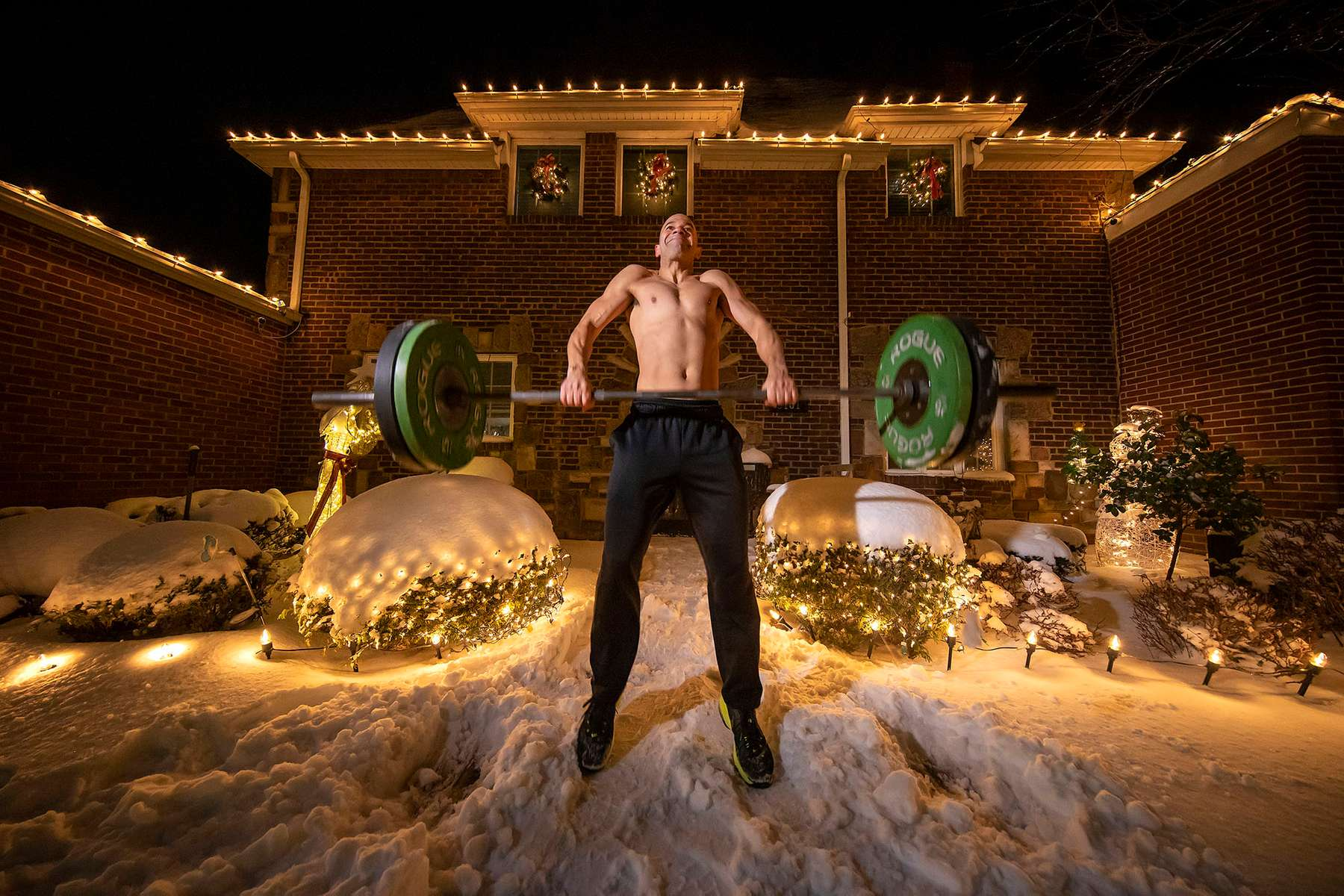 Loneil Jenkins exercises in front of his home after training with his virtual Fitness Trainer Dennis Guerrero on December 17th, 2020 in Oceanside, New York.  In March of 2014, Dennis Guerrero and his business partner opened a gym on Long Island. The pair shared a passion for fitness, a dream of creating a local community of like-minded people and a willingness to take a risk. Over the next six years, hundreds of members experienced and embraced a unique environment that fostered a palpable energy, helping athletes of all ages and abilities reach their potential.  The gym became a place to share achievements, work through losses and overcome illness. But like so many other businesses, it seemingly had no way of overcoming the financial impact and ongoing uncertainty of a global pandemic. With the arrival of Covid-19, the gym shut its doors back in March, with no idea when it would reopen. The owners, though, were far from done. They lent out every piece of equipment they owned to the gym's members, continued to pay their staff and worked to set up outdoor classes in hopes of keeping their membership active and healthy. As the shutdown stretched on, it became clear that the physical gym was closed for good.  They have since reinvented themselves and are now called Life Outside the Box.  Their business model has changed drastically, and all their workouts have gone virtual.  The workouts are conducted by a small group of fitness trainers led by Guerrero.  The members pay a monthly fee and can take live Zoom fitness classes.  They are coached by the virtual trainers in real time.  More and more people have reconstructed their garages, spare rooms, backyards, and basements into home gyms since the COVID-19 pandemic hit the United States.