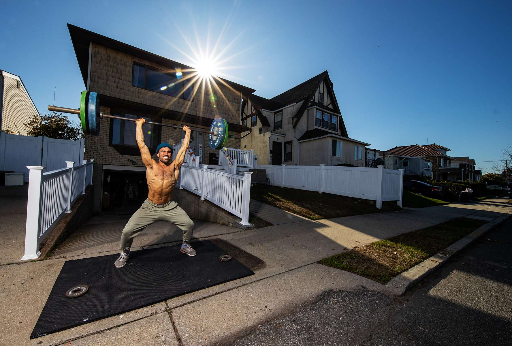 Dennis Guerrero, who is Co-owner, and Head Trainer of Life Outside the Box fitness trains outside his home on November 8th, 2020 in Long Beach, New York.   In March of 2014, Dennis Guerrero and his business partner opened a gym on Long Island. The pair shared a passion for fitness, a dream of creating a local community of like-minded people and a willingness to take a risk. Over the next six years, hundreds of members experienced and embraced a unique environment that fostered a palpable energy, helping athletes of all ages and abilities reach their potential.  The gym became a place to share achievements, work through losses and overcome illness. But like so many other businesses, it seemingly had no way of overcoming the financial impact and ongoing uncertainty of a global pandemic. With the arrival of Covid-19, the gym shut its doors back in March, with no idea when it would reopen. The owners, though, were far from done. They lent out every piece of equipment they owned to the gym's members, continued to pay their staff and worked to set up outdoor classes in hopes of keeping their membership active and healthy. As the shutdown stretched on, it became clear that the physical gym was closed for good.  They have since reinvented themselves and are now called Life Outside the Box.  Their business model has changed drastically, and all their workouts have gone virtual.  The workouts are conducted by a small group of fitness trainers led by Guerrero.  The members pay a monthly fee and can take live Zoom fitness classes.  They are coached by the virtual trainers in real time.  More and more people have reconstructed their garages, spare rooms, backyards, and basements into home gyms since the COVID-19 pandemic hit the United States.