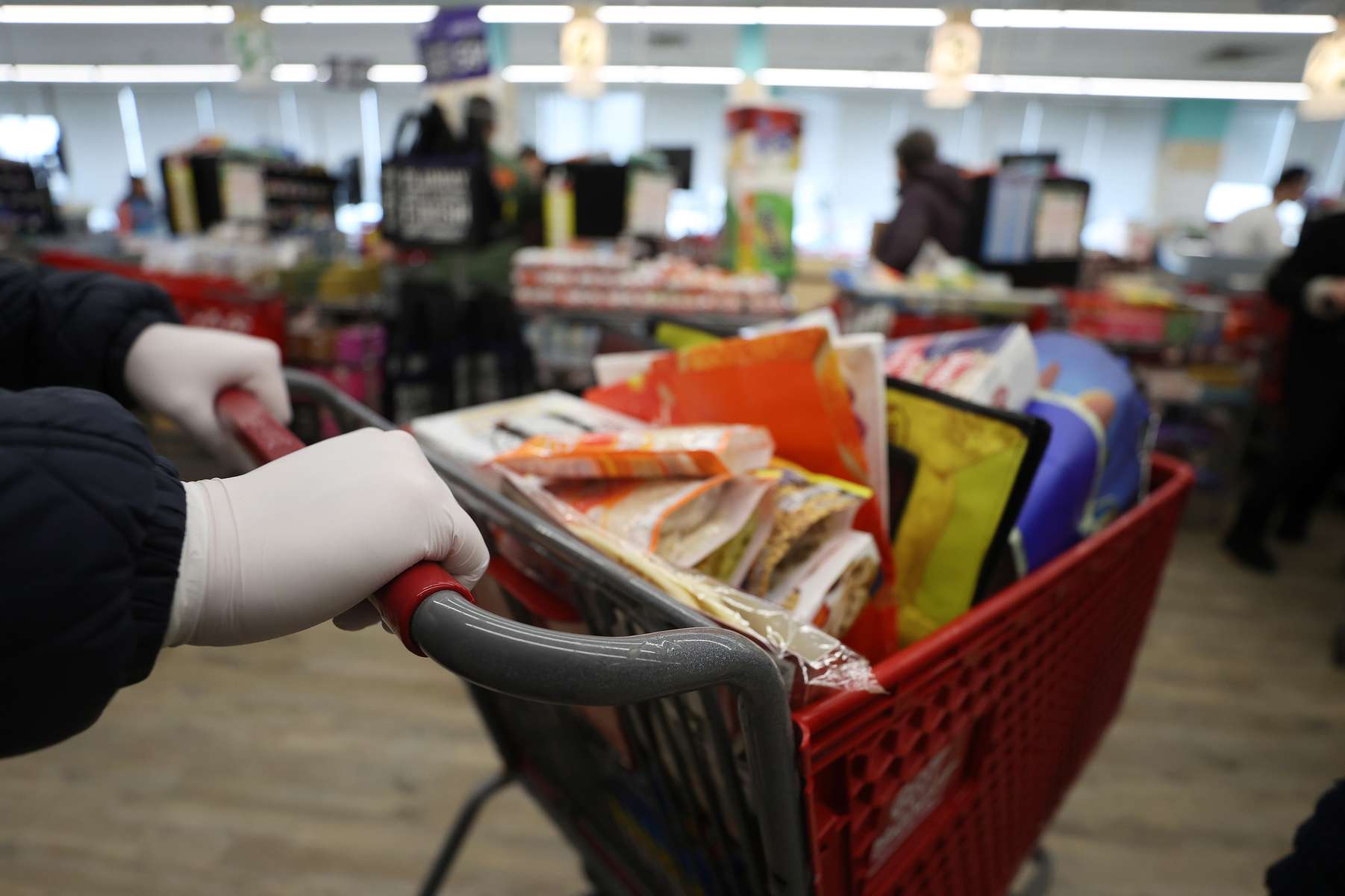 People wear latex gloves while food shopping.  As the coronavirus continues to spread across the United States, stores like Best Market had problems keeping up with the high demand for paper goods leading to empty shelves on March 17, 2020 in Merrick, New York. The World Health Organization declared coronavirus (COVID-19) a global pandemic on March 11th.
