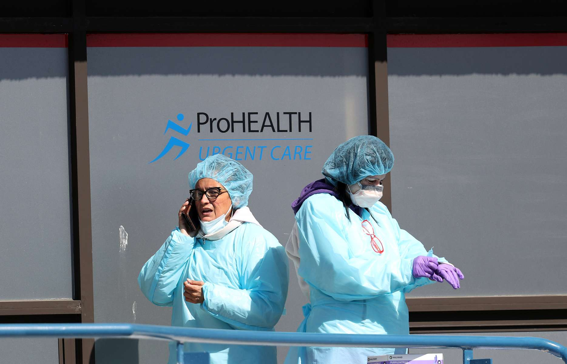 Medical professionals take a break at a drive-thru coronavirus testing site run by  ProHealth Care on April 06, 2020 in Jericho, New York. The World Health Organization declared coronavirus (COVID-19) a global pandemic on March 11th.