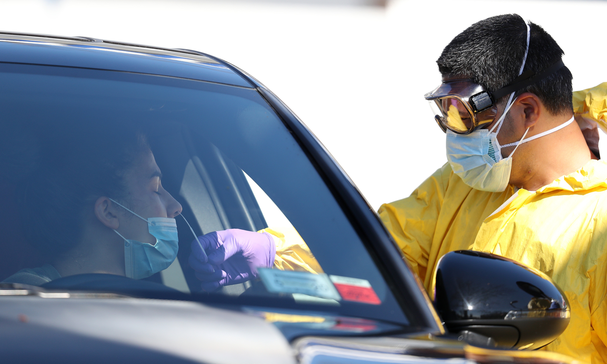 A medical professional administers a coronavirus test at a drive-thru coronavirus testing site run by  ProHealth Care on April 06, 2020 in Jericho, New York. The World Health Organization declared coronavirus (COVID-19) a global pandemic on March 11th.