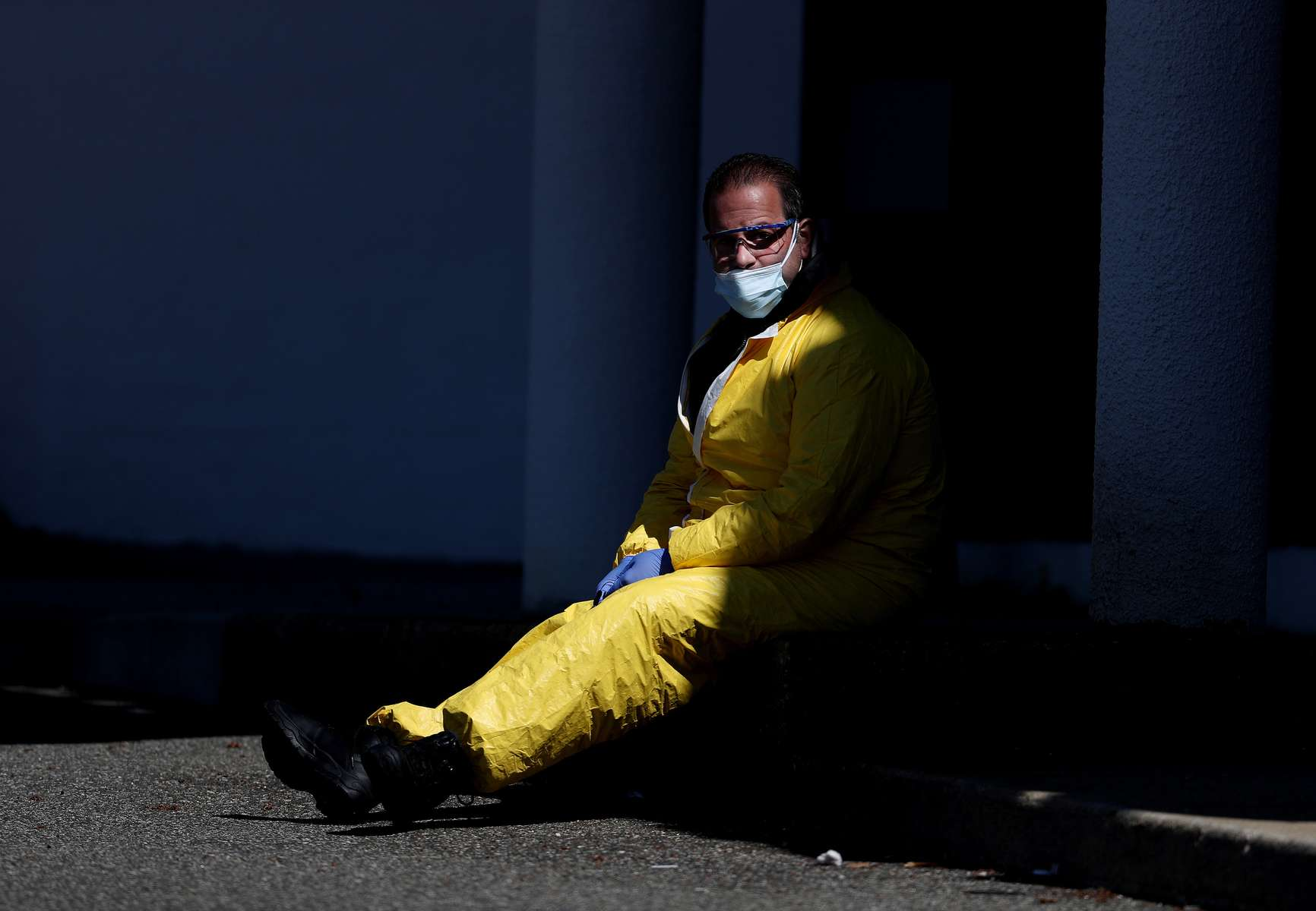 A Medical professional looks on at a drive-thru coronavirus testing site run by  ProHealth Care on April 06, 2020 in Jericho, New York. The World Health Organization declared coronavirus (COVID-19) a global pandemic on March 11th.