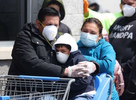 People wearing masks and gloves wait to enter Walmart on April 17, 2020 in Uniondale, New York. The World Health Organization declared coronavirus (COVID-19) a global pandemic on March 11th.