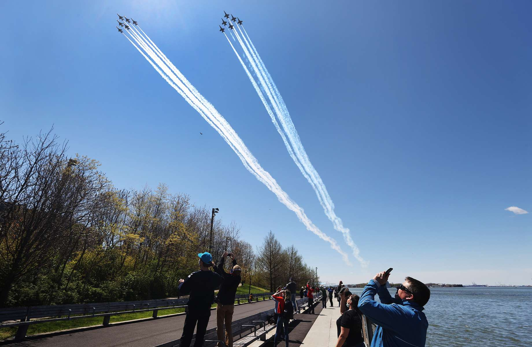 The U.S. Navy's Blue Angels and U.S. Air Force's Thunderbirds perform a flyover across Brooklyn Bridge park as a tribute to honor NYC COVID-19 frontline workers on April 28, 2020 in the Brooklyn borough of New York City.  The World Health Organization declared coronavirus (COVID-19) a global pandemic on March 11th.