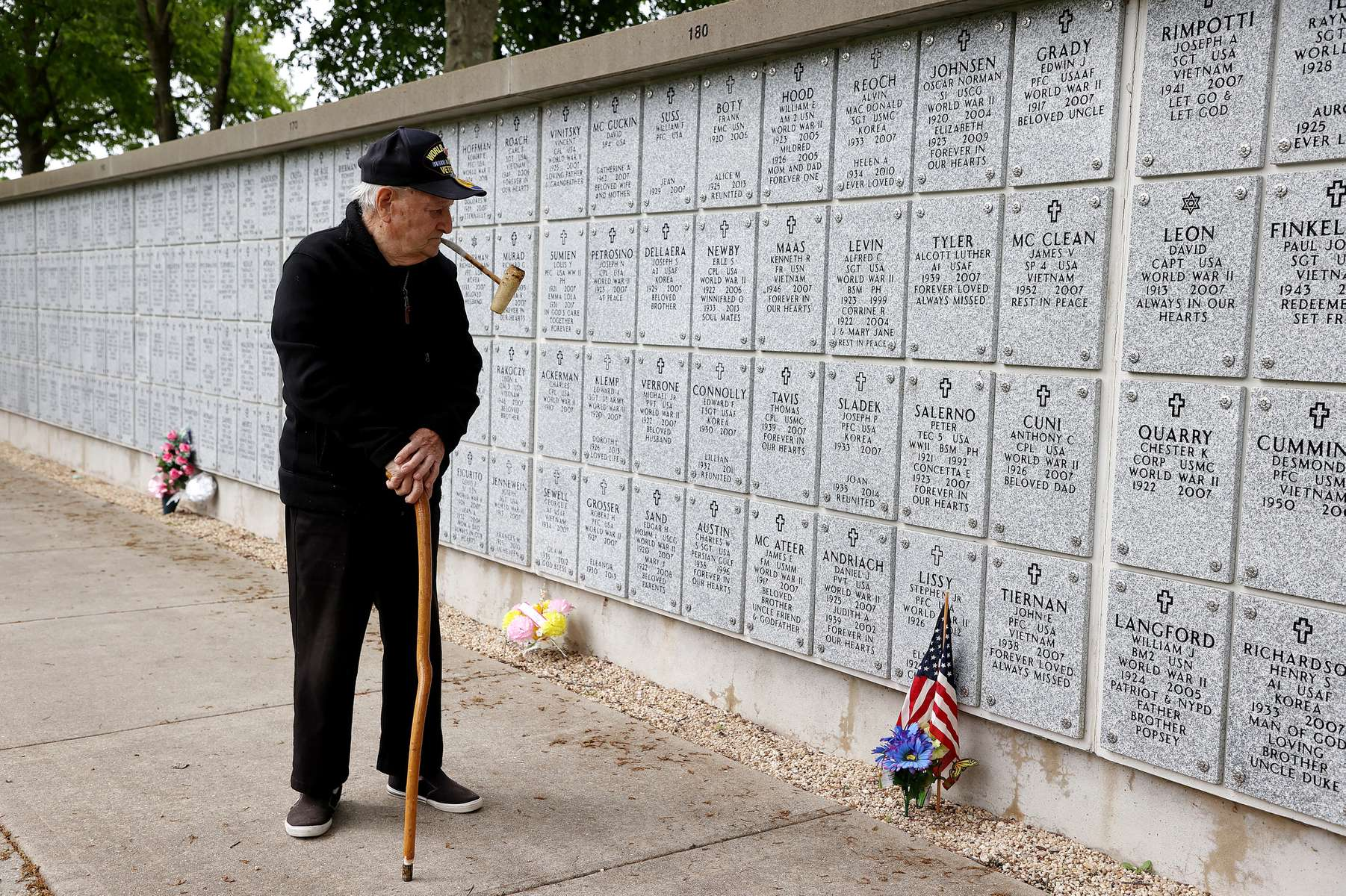 World War II Army Veteran Angelo Salerno visits the gravesite of his brother Peter Salerno who also served in World War II at Long Island National Cemetery on May 24, 2020 in Farmingdale, New York.  Health guidelines due to the coronavirus pandemic is expected to have a negative effect on those coming to pay their respects to veterans who lost their lives defending the country.