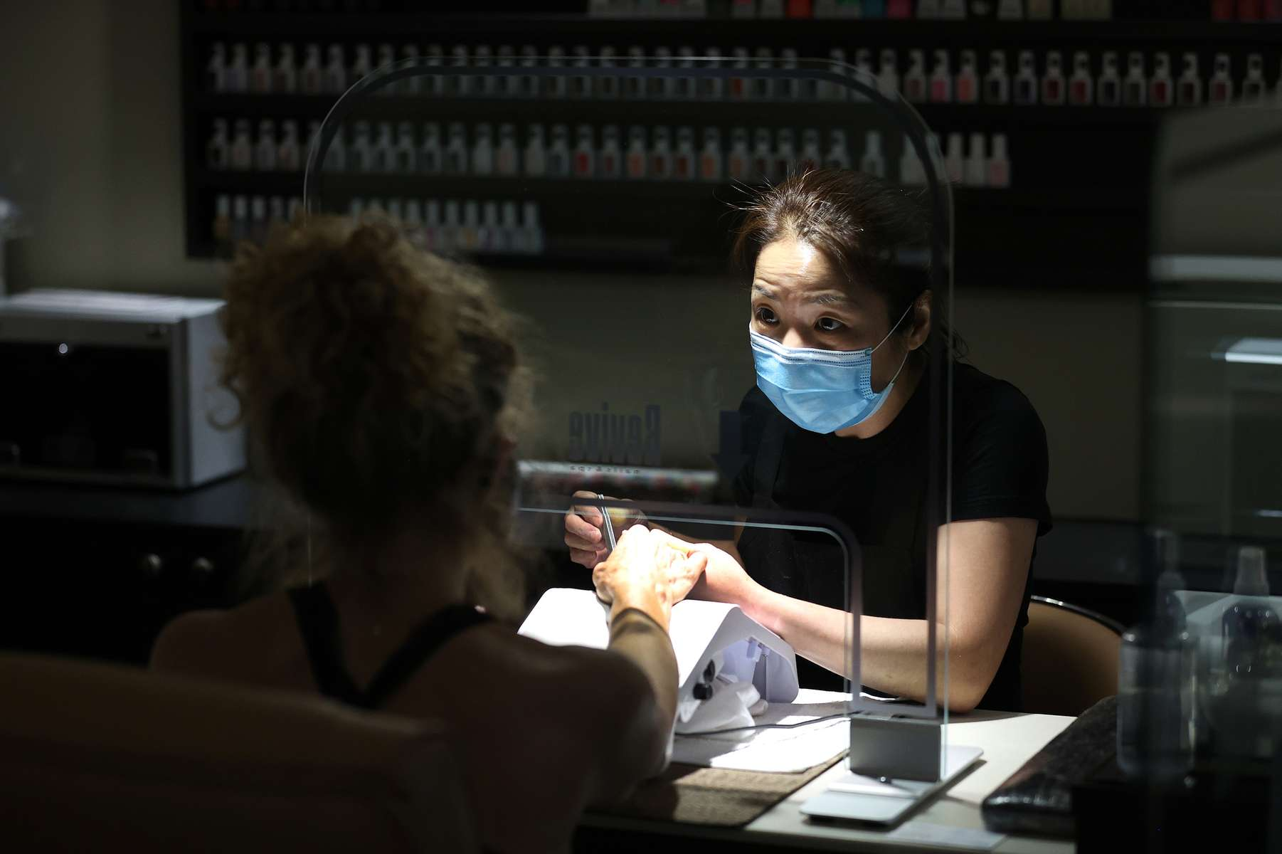 Vickie Lee does the nails of a customer at Revive Nails and Spa as Long Island begins Phase 3 of reopening, allowing restaurants To Seat Inside At 50 Percent Capacity and nail salons to open by appointment only on June 24, 2020 in Huntington, New York.