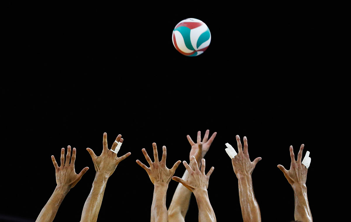 A general view of hands reaching for the ball during the Men's Volleyball finals at the Pan Am Games on July 26, 2015 in Toronto, Canada.