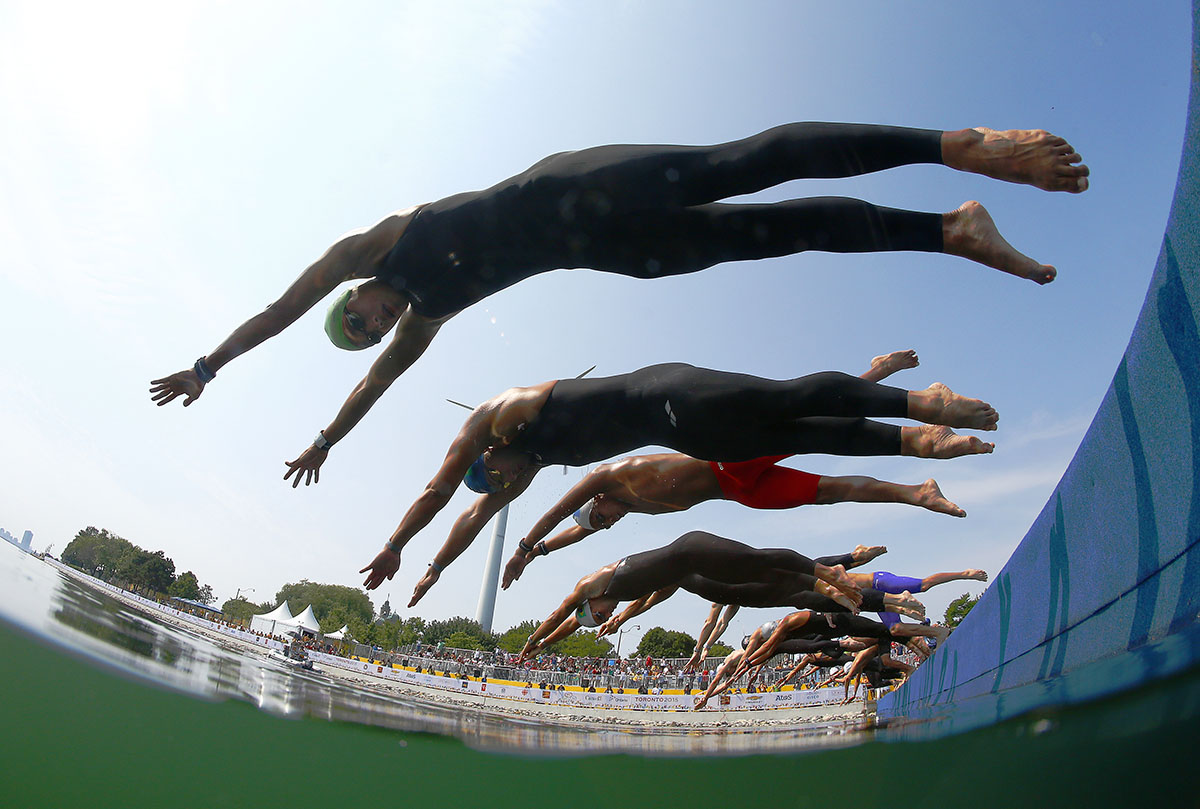 The competitors start the Men's 10k Open Water race on July 12, 2015 in Toronto, Canada.