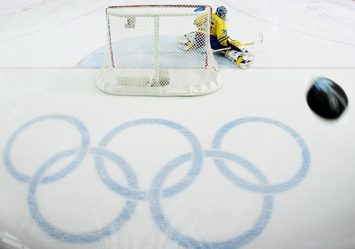 Henrik Lundqvist #35 of Sweden watches the puck fly by during the quarter final of the men's ice hockey match between Sweden and Switzerland during Day 12 of the Turin 2006 Winter Olympic Games on February 22, 2006 at the Torino Esposizioni in Turin, Italy.