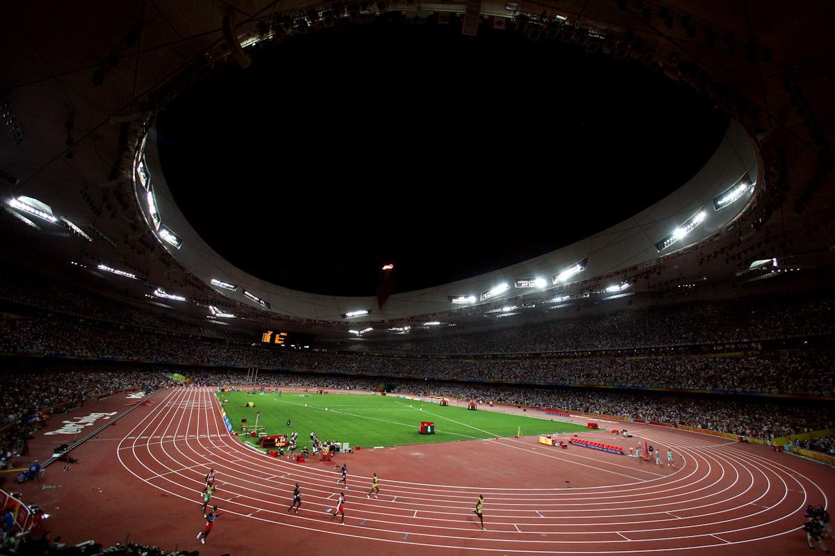 Usain Bolt of Jamaica celebrates as he crosses the line in the Men's 100m Final at the National Stadium on Day 8 of the Beijing 2008 Olympic Games on August 16, 2008 in Beijing, China. Bolt clocked a new world record time of 9.69 seconds.