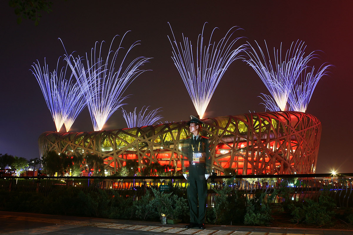 A Guard stands watch as fireworks go off during the Closing Ceremony for the Beijing 2008 Olympic Games on August 24, 2008 in Beijing, China.
