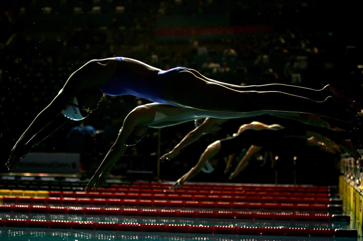Andreina Pinto of Venezuela dives in to start her 200m Individual Medley heat during the XII FINA World Championships at the Rod Laver Arena on March 25, 2007 in Melbourne, Australia.