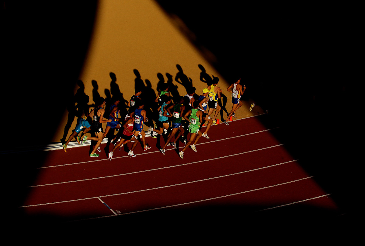 Competitors run the 10,000 meter final during Day 10 of the XVI Pan American Games at Telcel Athletics Stadium on October 24, 2011 in Guadalajara, Mexico.