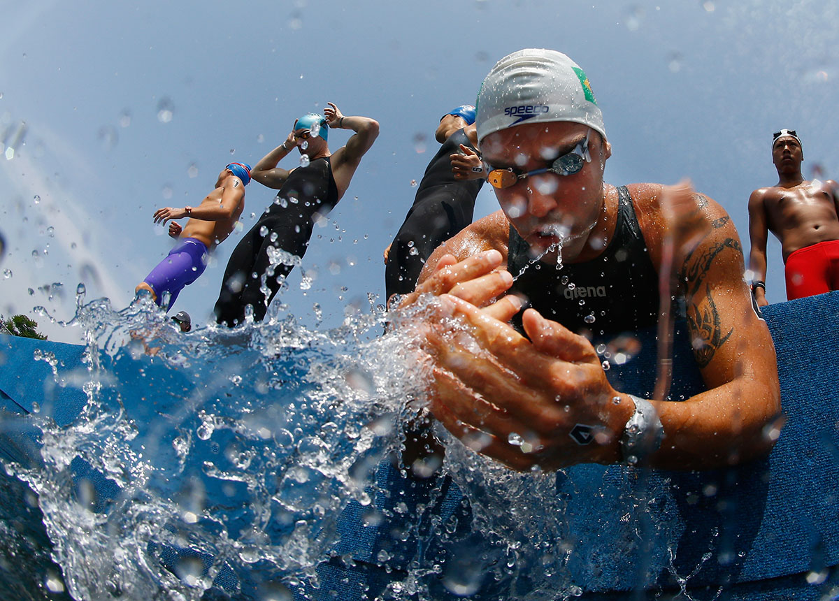Arapiraca Lima of Brazil splashes water on his face before the start of the Men's 10k Open Water race on July 12, 2015 in Toronto, Canada.