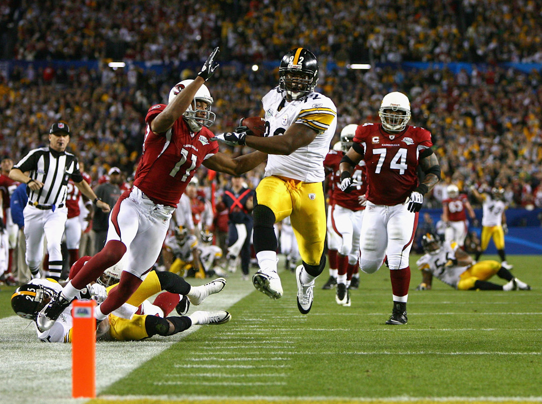 James Harrison #92 of the Pittsburgh Steelers scores a touchdown after running back an interception for 100 yards in the second quarter against the Arizona Cardinals during Super Bowl XLIII on February 1, 2009 at Raymond James Stadium in Tampa, Florida.