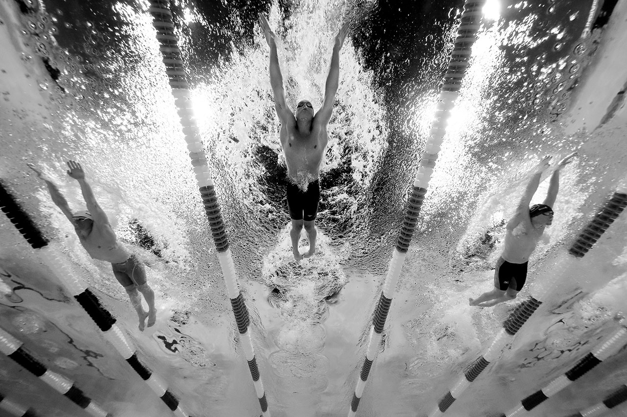 (L-R) Austin Surhoff, Ryan Lochte and Gunnar Bentz of the United States compete in a semi-final heat for the Men's 200 Meter Individual Medley during Day Five of the 2016 U.S. Olympic Team Swimming Trials at CenturyLink Center on June 30, 2016 in Omaha, Nebraska.