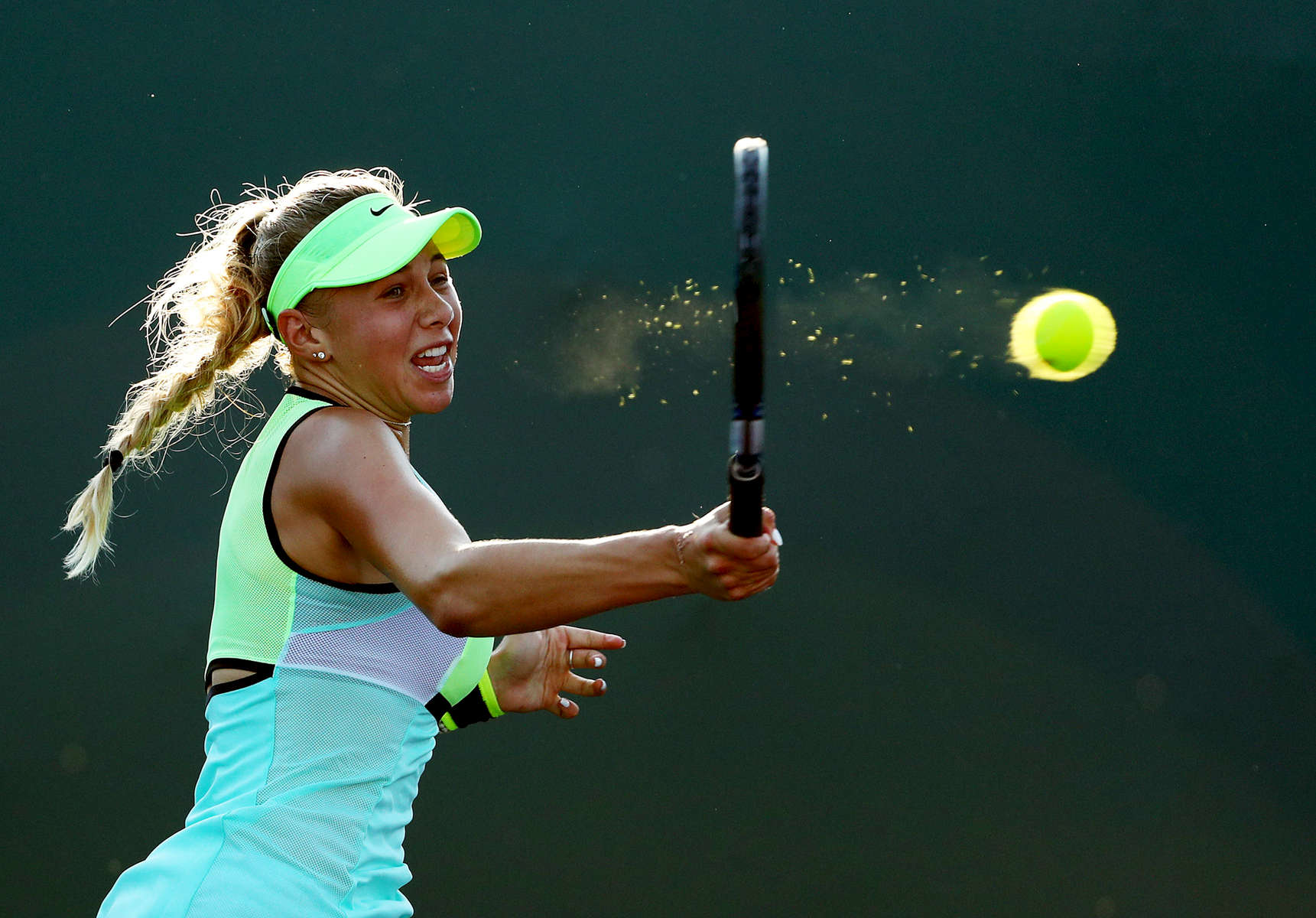 Amanda Anisimova returns a shot against Taylor Townsend  during day 3 of the Miami Open at Crandon Park Tennis Center on March 22, 2017 in Key Biscayne, Florida.