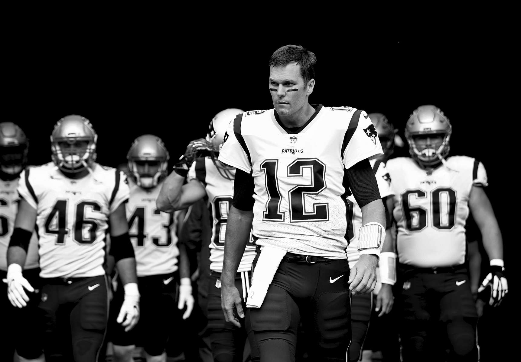 Tom Brady #12 of the New England Patriots leads his team onto the field against the New York Jets before their game at MetLife Stadium on October 15, 2017 in East Rutherford, New Jersey.