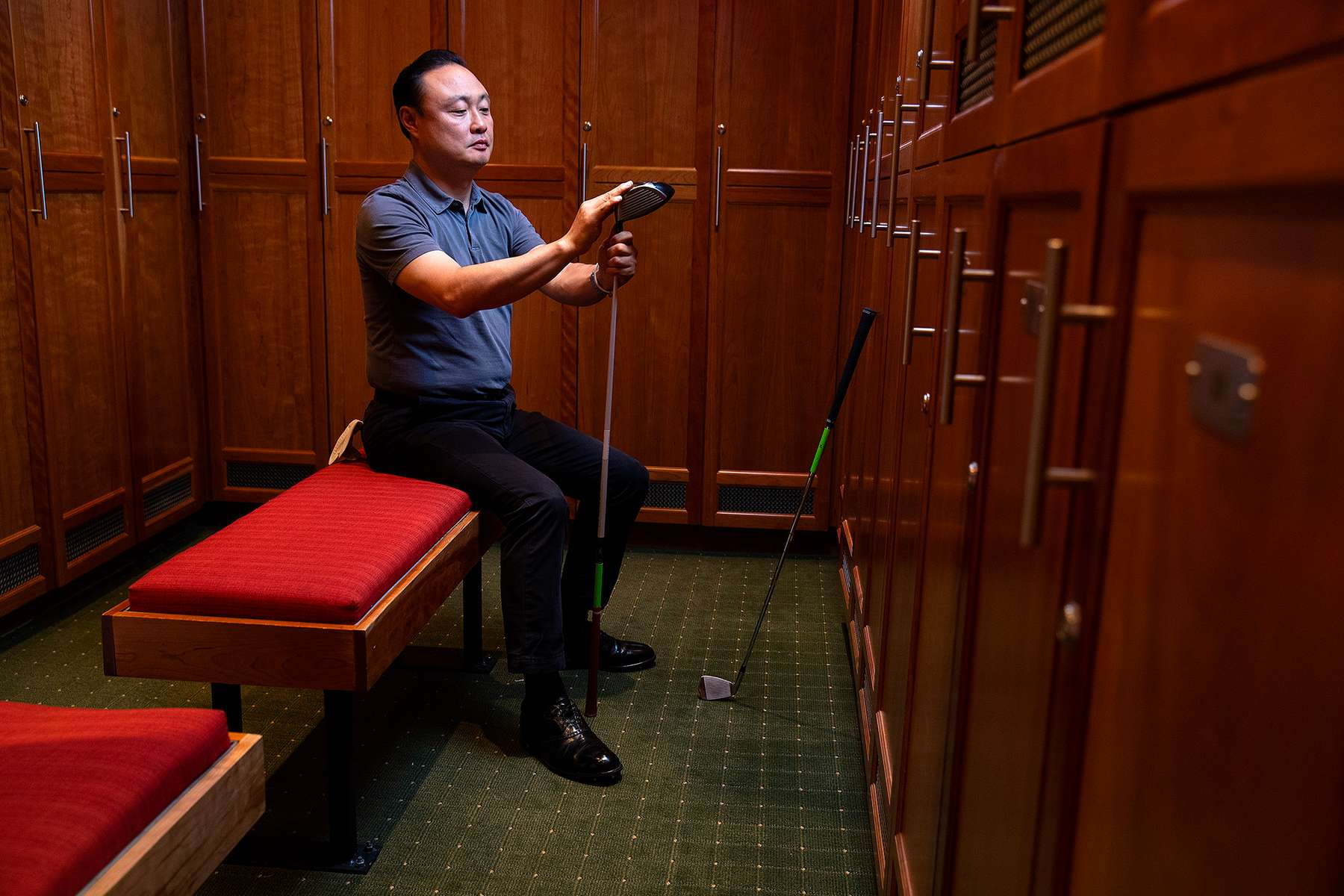 A Senior Golfer sits in the Clubhouse before a round of Golf.